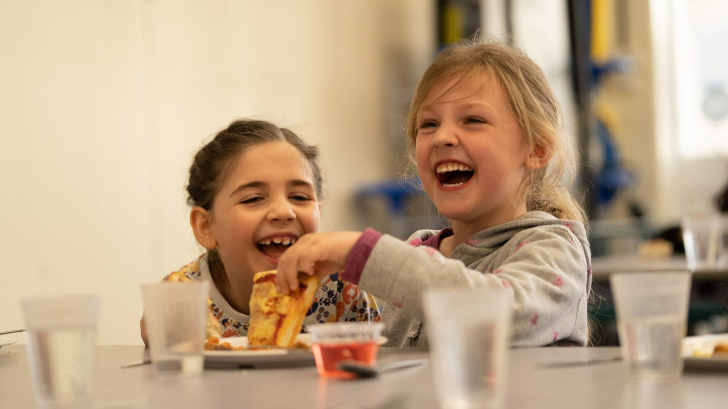 Two students enjoying their lunch
